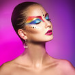 Charming woman with colorful make up on purple background