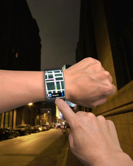 hand wearing wrist watch with GPS
