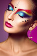 Sexual adult female with closed eyes and multicolor make up
