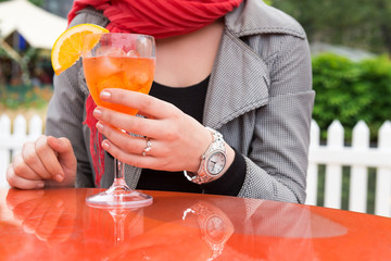 Attractive young woman enjoying cocktail in an outdoor bar