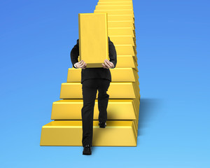 man carrying bullion and climbing gold stairs