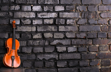 violin on brick wall background for text music