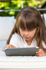 Girl staring at tablet