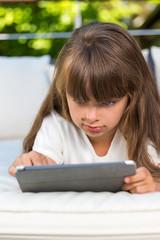 Girl staring at tablet