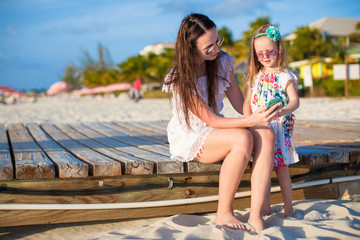 Happy mother and little daughter at caribbean beach