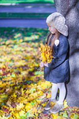 Cute little girl at warm sunny autumn day outdoor