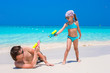 Happy father and his adorable little daughter at tropical beach