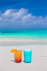 Two tasty cocktails on the white sandy beach