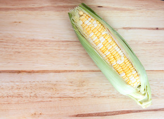 two tone of sweet Corn on wooden background