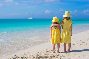 Back view of two adorable little girls on caribbean vacation