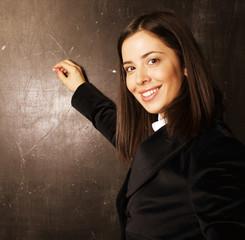 portrait of happy cute student in classroom at blackboard