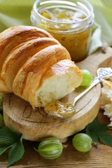 Breakfast croissant with fresh jam of green gooseberry