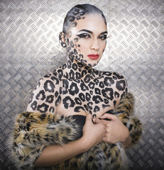 young  sexy woman with leopard make up