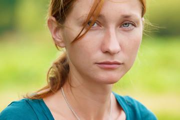 Serious young woman looking at camera