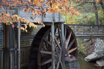 Wooden grist mill grinding water wheel