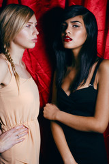 brunette and blond woman together, conflict of types