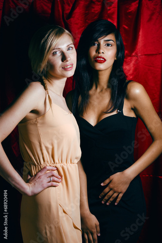 canvas print picture brunette and blond woman together, conflict of types