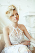 beauty blond bride in luxury white interiors