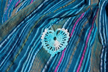openwork heart on a blue striped fabric called sirsaker
