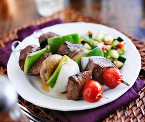 steak and vegetable shishkabob skewers with cucumber salad