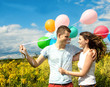 Happy young couple in love with colorful balloons :)