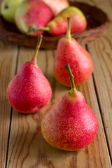 Ripe red pears on the wooden table
