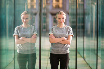 Young business woman in modern glass interior