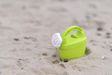 gieter op het strand