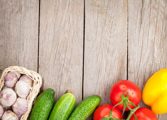 Fresh ripe vegetables on wooden table