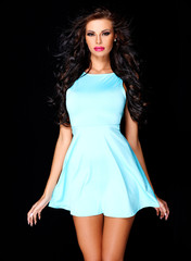 Cute young brunette posing in blue dress