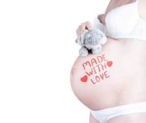 "Pregnant belly with ""Made with love"" sign isolated"