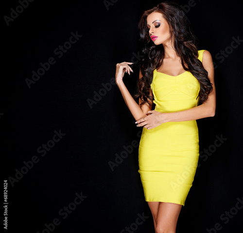 canvas print picture Sexy slim brunette posing in yellow dress