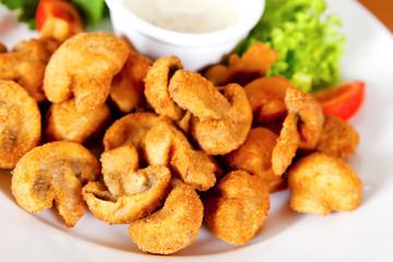 Deep-fried champignon mushrooms
