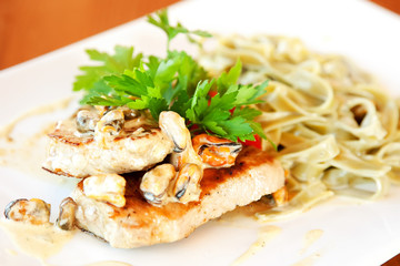 Fettuccine with mussels and grilled salmon