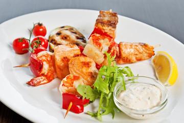 Salmon and prawns kebabs