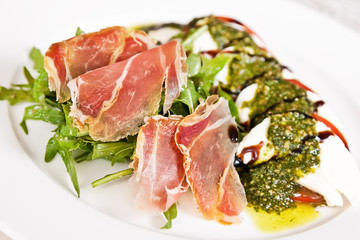 Caprese salad with parma ham