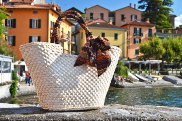 Basket against varenna town, lake Como, Italy