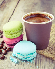 macaroons and espresso coffee cup  on wooden rustic table