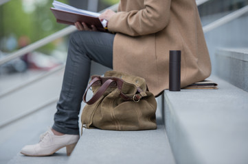 Woman stairs reading book