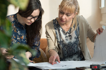 Woman meeting architect plans home