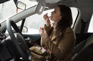 Woman doing makeup car