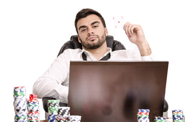 Laid back poker player playing online getting rich