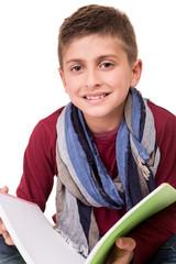 Boy holding a sketchbook