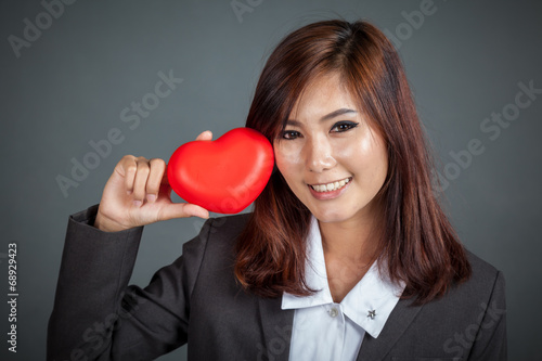 canvas print picture Close up Asian businesswoman happy and smile  with red heart