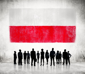 Silhouettes of People and a Flag of Poland