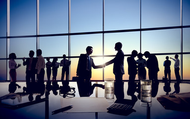 Two Isolated Businessmen Handshaking