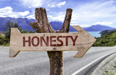 Honesty wooden sign with a street background