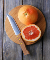 Ripe grapefruits and knife