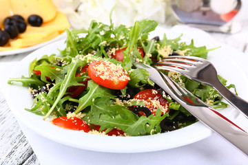 Fresh salad with arugula, close up