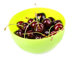 Fresh cherries in green plastic bowl isolated on white